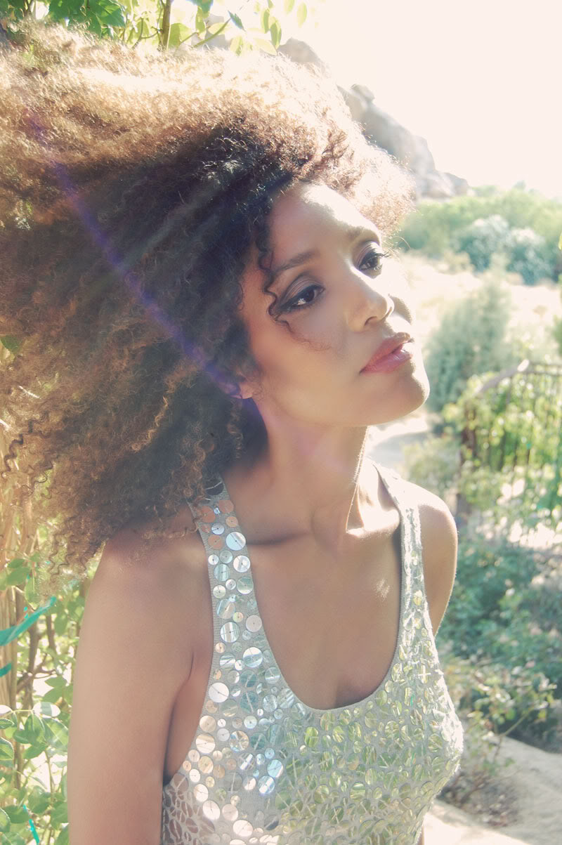 doema enjoys some peace in nature and shares her love of green living in a silver sequined metallic dress.