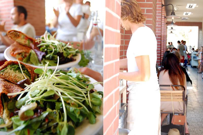 The Global Girl enjoys her favorite raw vegan Mediterranean wrap with live falafels at vegan restaurant Cafe Gratitude in Venice, California.