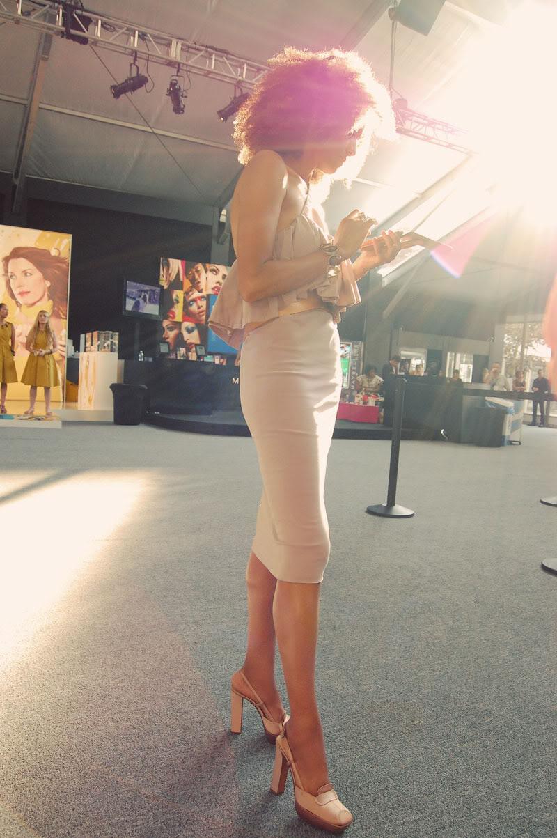 Ndoema The Global Girl arrives at New York Fashion Week wearing an Alexander Terekhov ruffle dress and Prada satin pumps