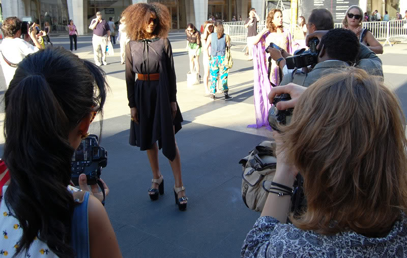 Ndoema The Global Girl wears a dress by Mexican designer Cesar Arrellanes, belt by Acne and shoes by Report Signature during New York Fashion Week.