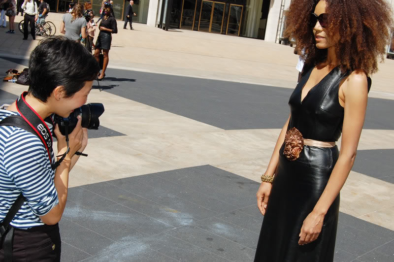 Ndoema The Global Girl arrives at the Lincoln Center during New York Fashion Week. Ndoema wears a black leather dress, ethnic belt, Report Signature shoes and Chloe Sunglasses