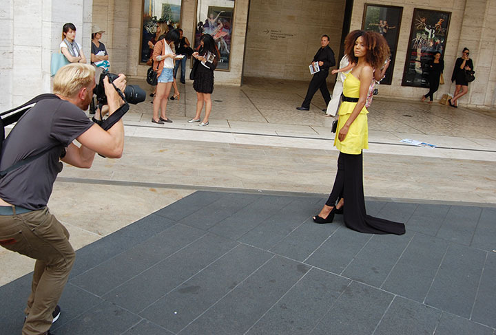 Ndoema The Global Girl wears pants skirt by Turkish-born, UK-based designer Hakaan Yildirim. Patent leather wedges by Charles Jourdan. Zipper leather clutch by Karen Millen