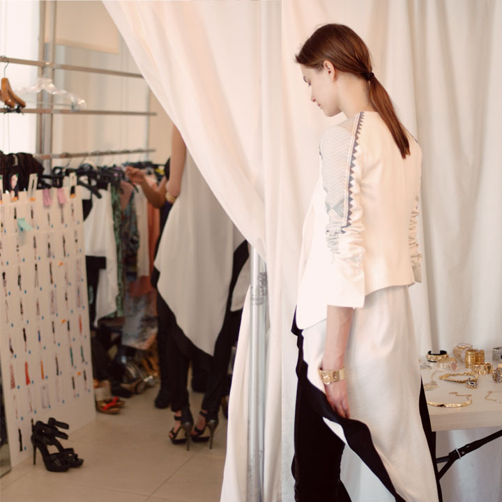 The Global Girl: Behind-the-scenes at Hever Leger by Max Azria Fall 2013 runway. A gorgeous model during a fitting for the Hervé Léger Fall 2013 runway show.