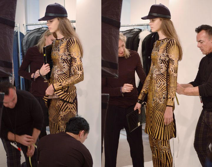The Global Girl: Behind-the-scenes at Hever Leger by Max Azria Fall 2013 runway. Creative Director Lubov Azria is busy at work overseeing every detail of the forthcoming collection.