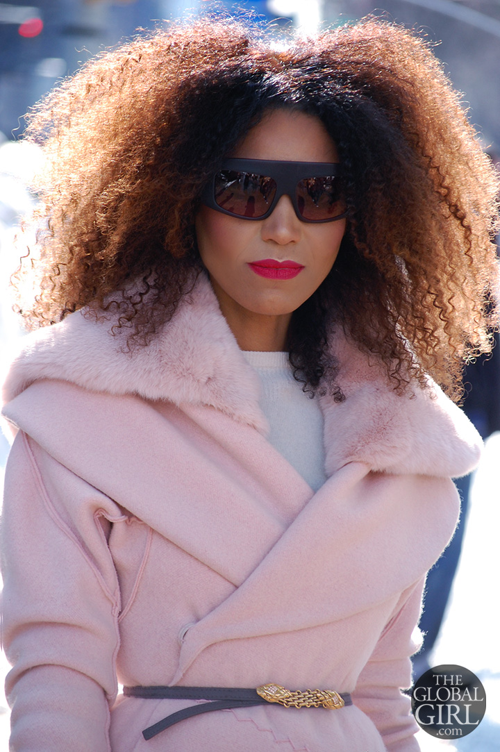 The Global Girl Daily Style: Ndoema rocks an all pink outfit with purple oversized Phillip Lim sunglasses as she arrives at Lincoln Center during New York Fashion Week.