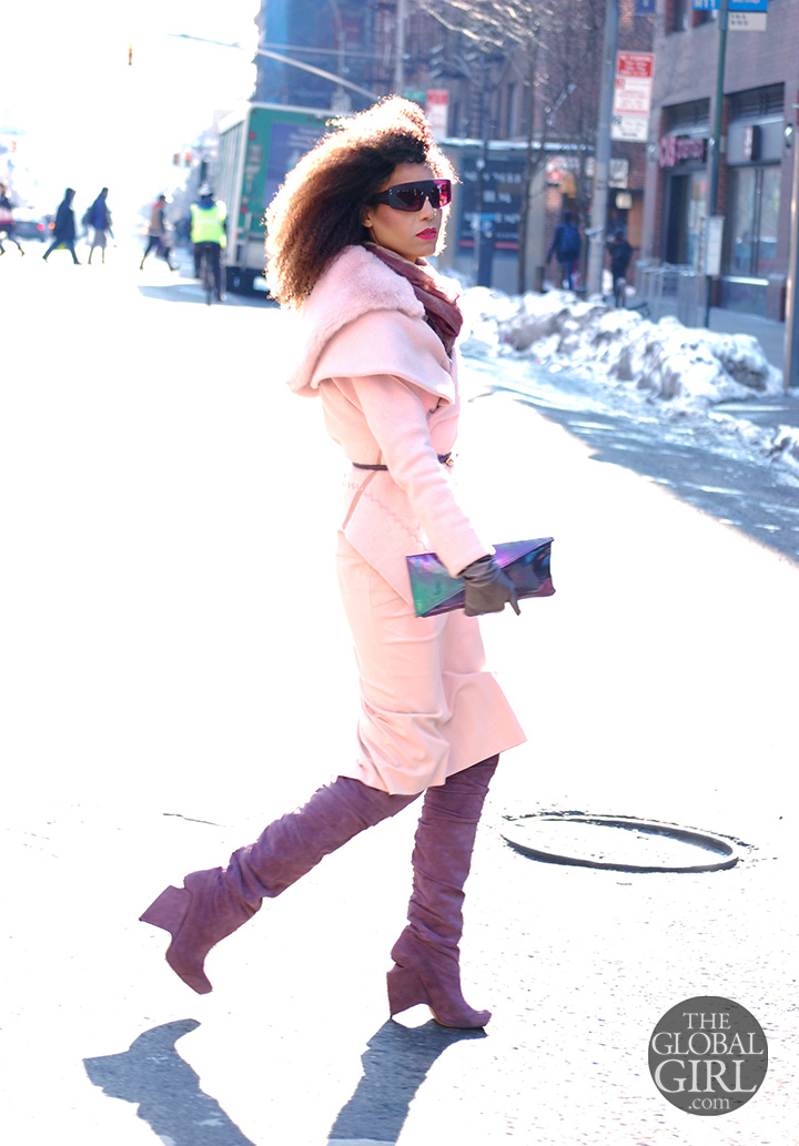 The Global Girl Daily Style: Ndoema rocks an all pink outfit with Nicholas Kirkwood lavender thigh-high boots, matching hologram clutch bag and oversized Phillip Lim sunglasses as she arrives at Lincoln Center during New York Fashion Week.