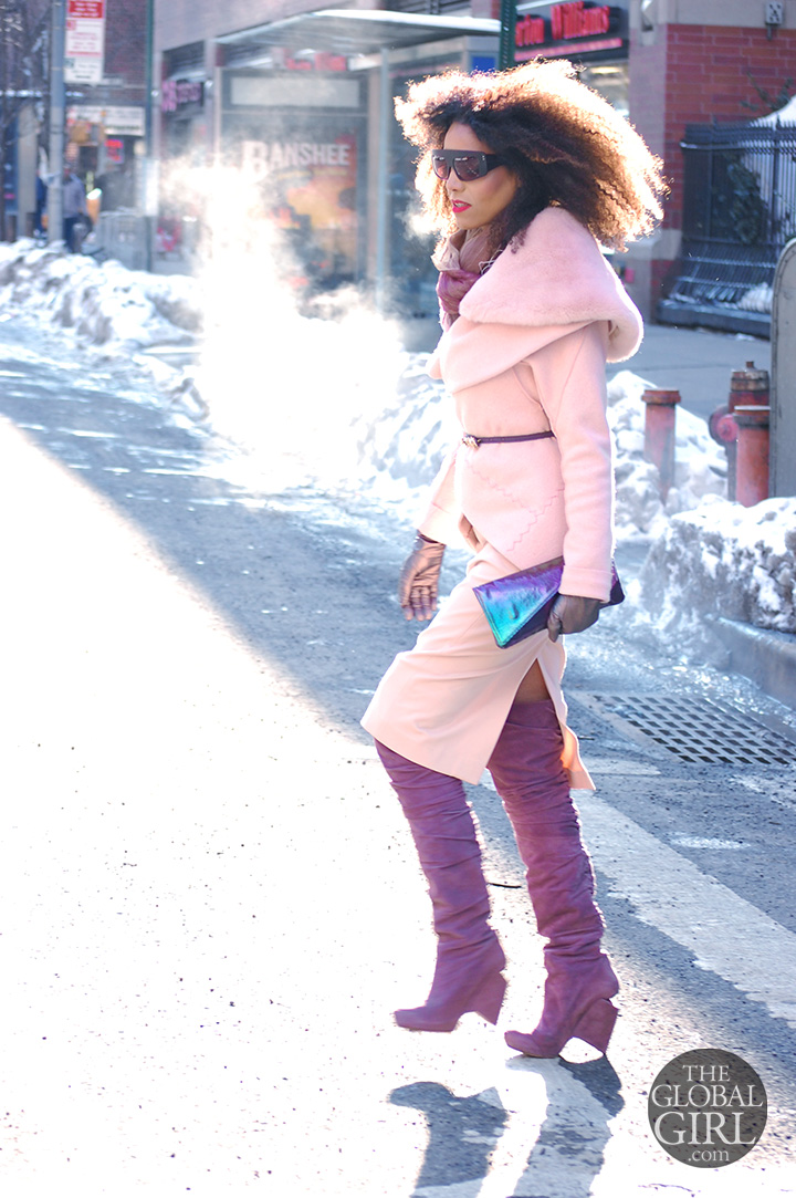 The Global Girl Daily Style: Ndoema rocks an all pink outfit with lavender Nicholas Kirkwood thigh-high boots, matching hologram clutch bag and oversized Phillip Lim sunglasses as she arrives at Lincoln Center during New York Fashion Week.