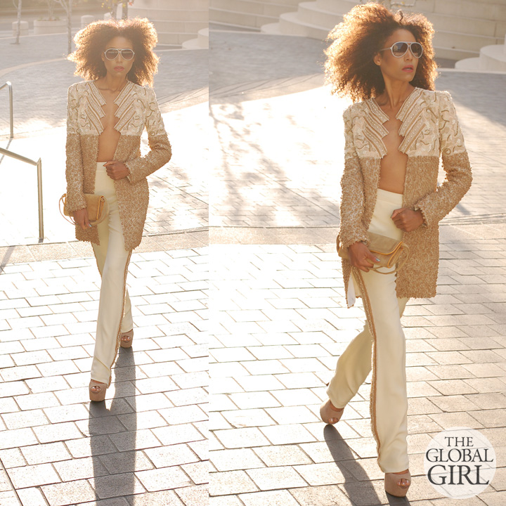 The Global Girl Fashion Editorials: Ndoema sports a beaded tuxedo stripe pants with matching jacket ensemble by Mimi Plange. Vintage suede clutch bag. Beige suede platform stilettos by Betsey Johnson. Aviator sunglasses by Matthew Williamson.