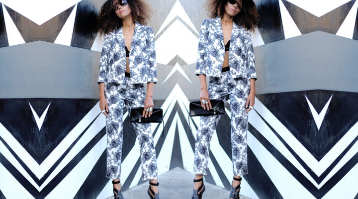 The Global Girl Daily Style: Ndoema rocks a graphic black and white, head-to-toe floral print pants and jacket ensemble with Karen Millen leather clutch, gladiator platform stiletto sandals by BCBG Max Azria, lace bralette and oversized sunglasses by Chloé.