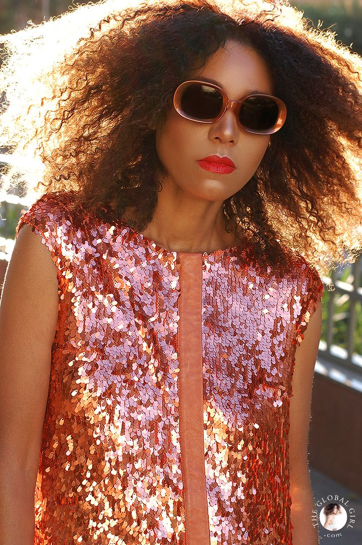 The Global Girl Daily Style: Ndoema dons a sequin mini dress from Son Jung Wan Spring 2014 with mod rounded sunglasses by Halston.