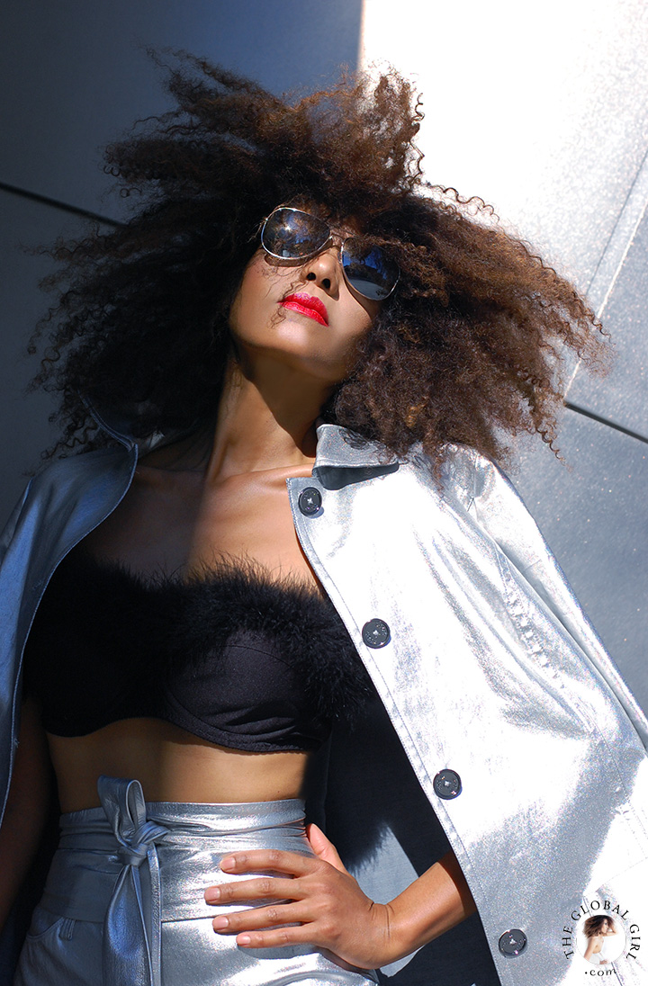 The Global Girl Editorials: Ndoema rocks the metallic look in silver jacket, mirrored aviator sunglasses by Le Specs and feathered bra.