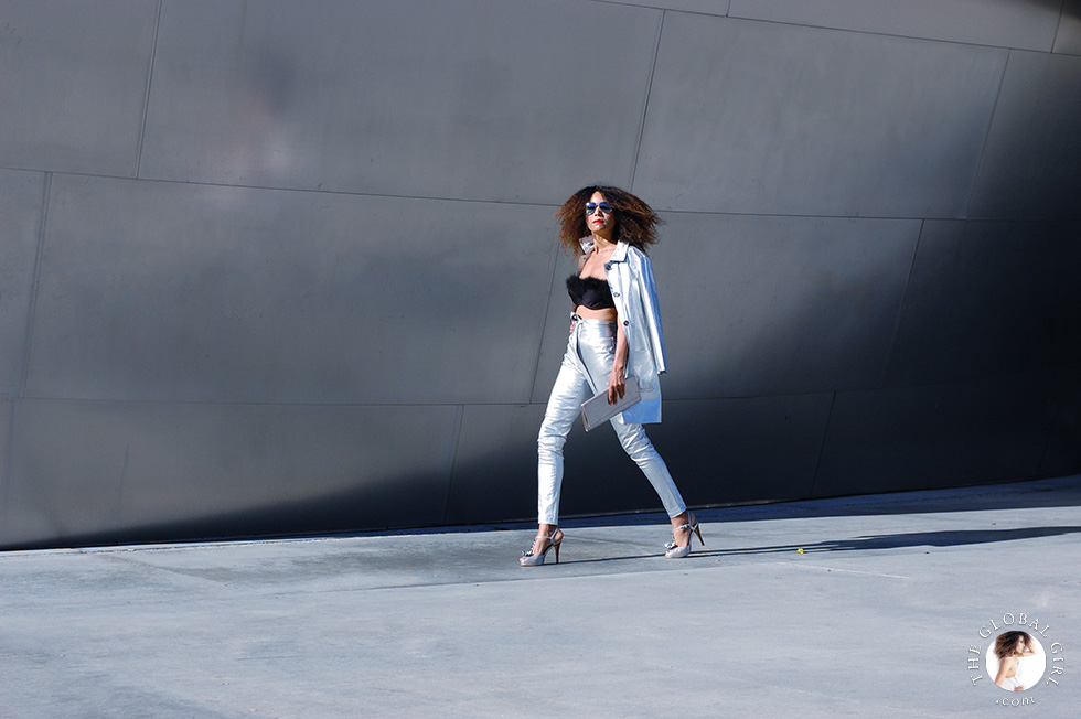 The Global Girl Editorials: Ndoema rocks the metallic look in skinny jeans with matching jacket, mirrored aviator sunglasses, feathered bra and silver platform sandals and clutch bag.