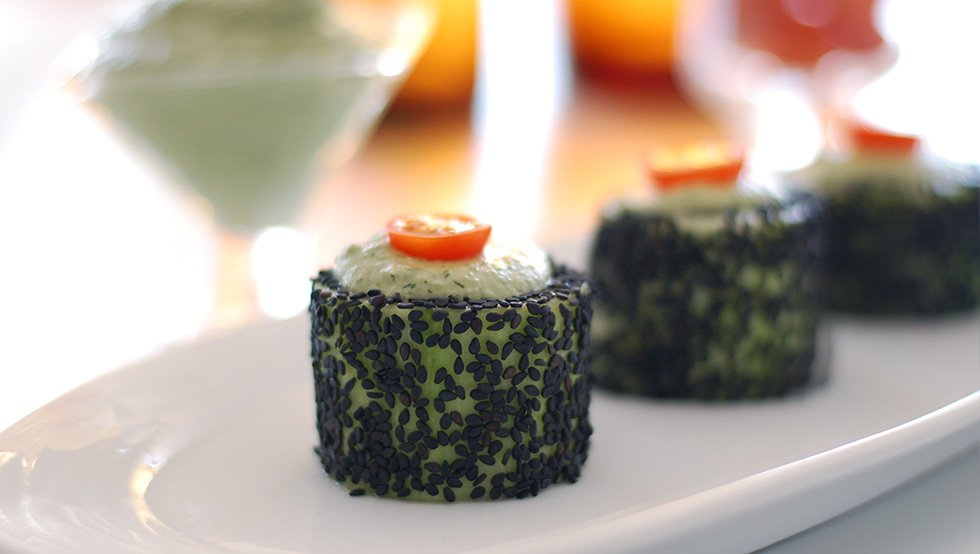 "Healthy Memorial Day Recipes with The Global Girl: Impress family and friends with these fun Cucumber Rolls with Herbed Cashew Cheese. These fun and tasty appetizers are a take on the classic Japanese cucumber maki but without rice and with sesame seed ""breading"" in lieu of nori sheets.."