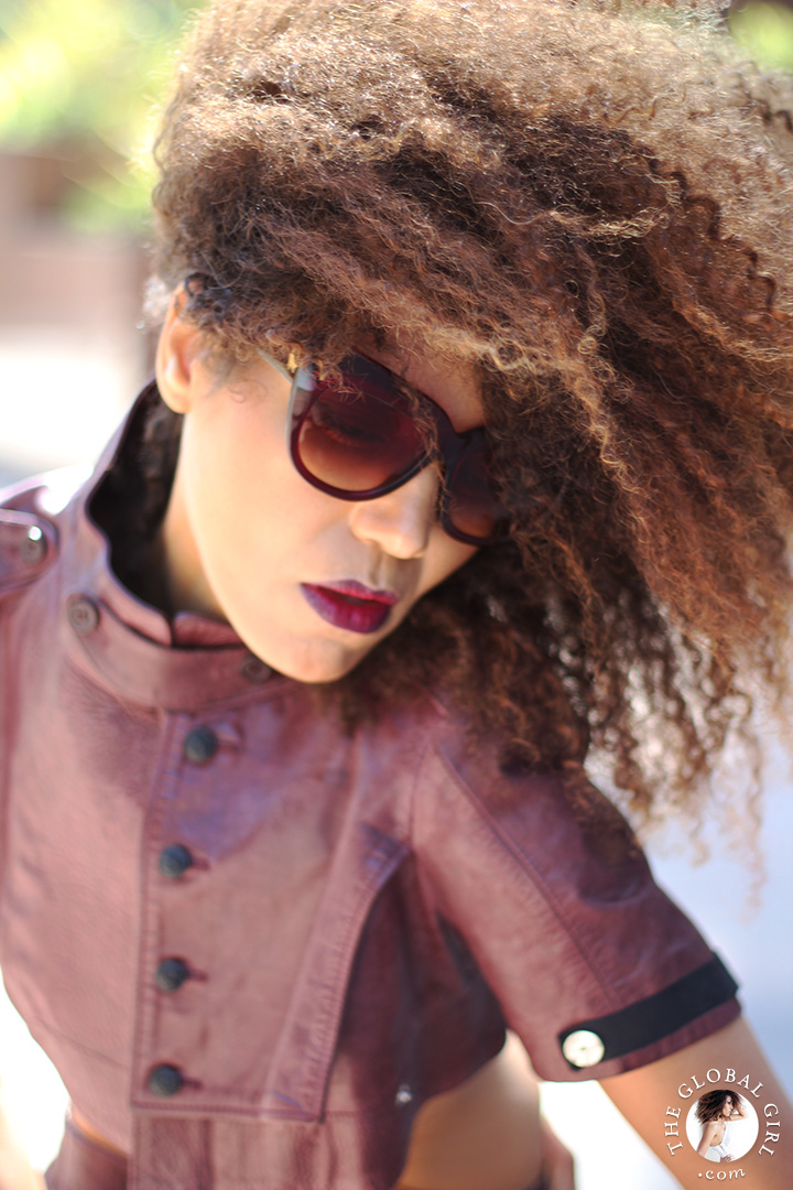 Ndoema is rocking a cropped leather jacket by Diesel  | Tom Ford lip color in bruised plum | House of Harlow 1960 Chelsea Cateye Sunglasses.