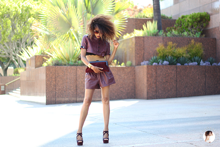 Ndoema is rocking a cropped leather jacket by Diesel  | House of Harlow 1960 Chelsea Cateye Sunglasses |Tom Ford lip color in bruised plum | Vintage burgundy leather shorts  | Vintage burgundy suede and bakelite clutch | Gold metal heel suede platform stilettos by Topshop  | Kenneth Jay Lane pyramid studded bracelet.
