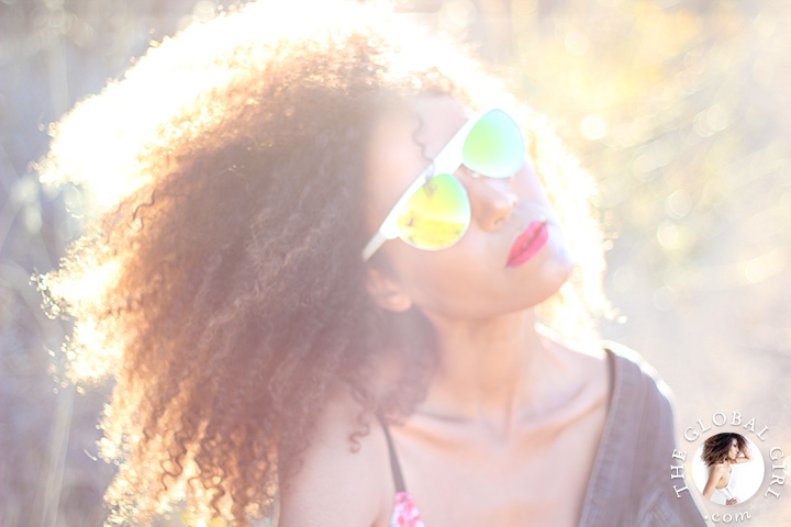 Ndoema rocks green aviator mirrored sunglasses.