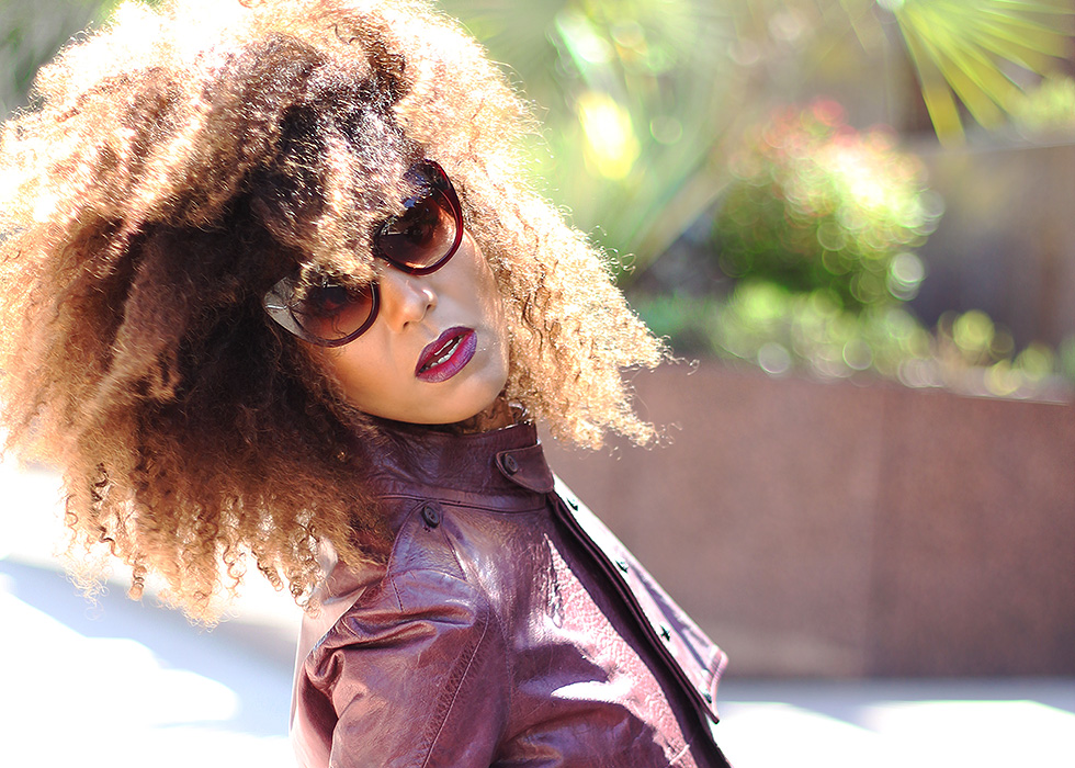 Ndoema is rocking a cropped leather jacket by Diesel , Tom Ford lip color in bruised plum and House of Harlow 1960 Chelsea Cateye Sunglasses