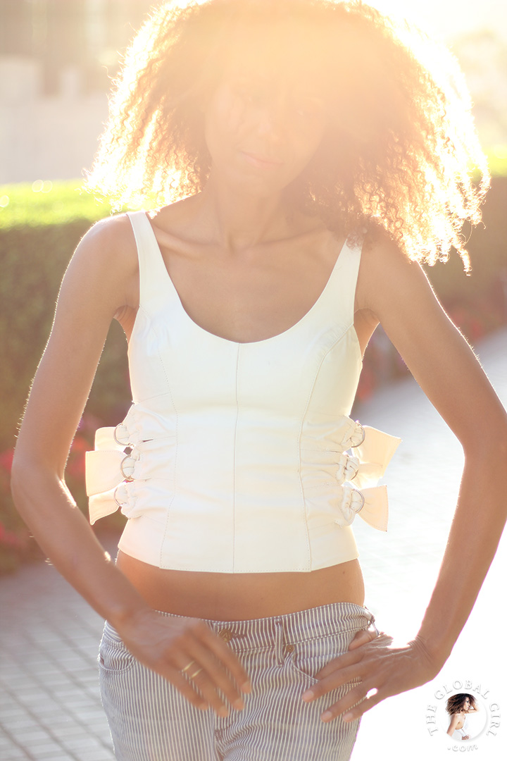 Ndoema rocks the midriff look in low rise flare jeans by J Brand and a vintage leather cropped top.