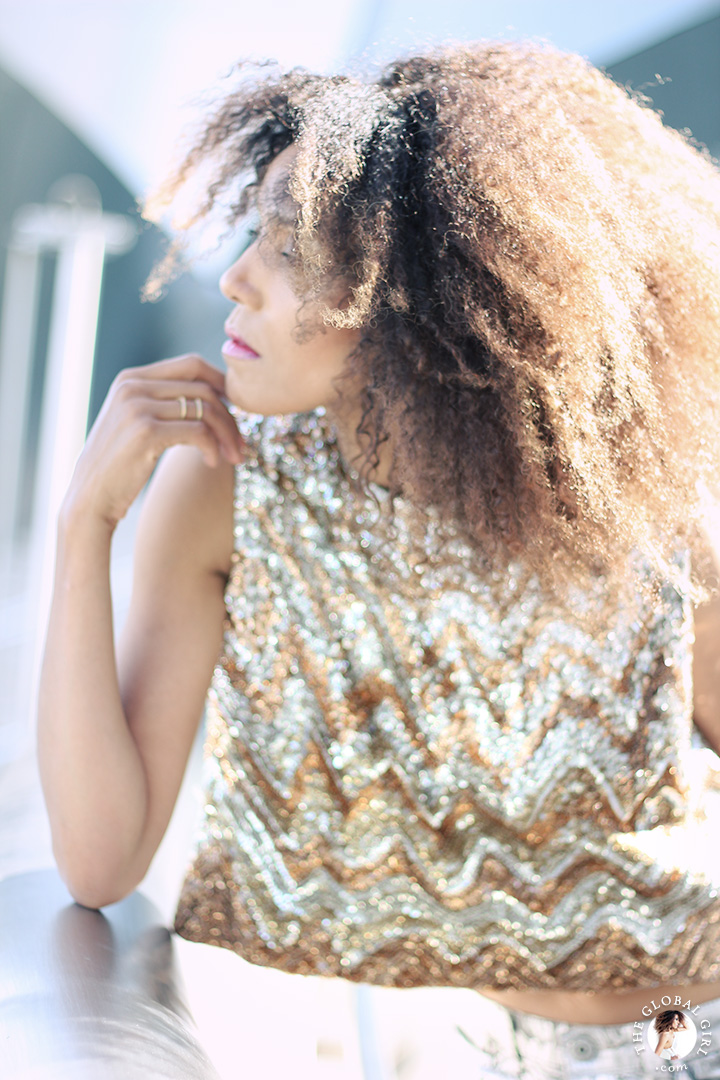 Ndoema sports a vintage sequin cropped top and Neoteric gold vermeil double ring by Maison Antonym.