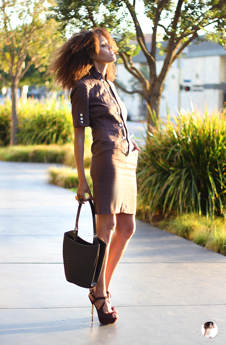 Ndoema is wearing a brown linen safari dress by Louis Féraud Paris   Topshop metal heeled platform suede sandals   Quilted leather tote by Bally.