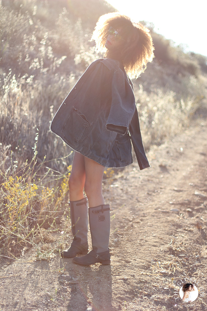 Ndoema rocks summer canvas and leather boots and and a men's denim jacket.