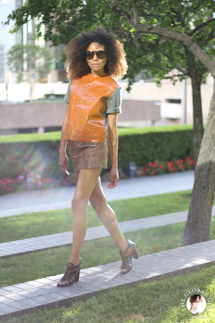 Ndoema rocks the all leather look with a mini leather skirt by Diesel and leather top by Marni for H&M with Carrera aviator sunglasses and Max Studio patent leather sandals.
