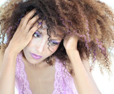 """Ndoema rocks her trademark curly hair styled with Garnier Color Styler in Purple Mania, in a """"purple everything"""" look complete with purple curls, purple smokey eyes and bold purple lips. #purplehair #purpleeverything"""