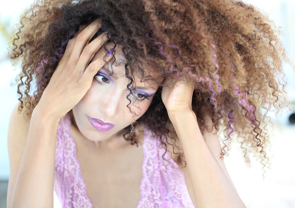 "Ndoema rocks her trademark curly hair styled with Garnier Color Styler in Purple Mania, in a ""purple everything"" look complete with purple curls, purple smokey eyes and bold purple lips. #purplehair #purpleeverything"