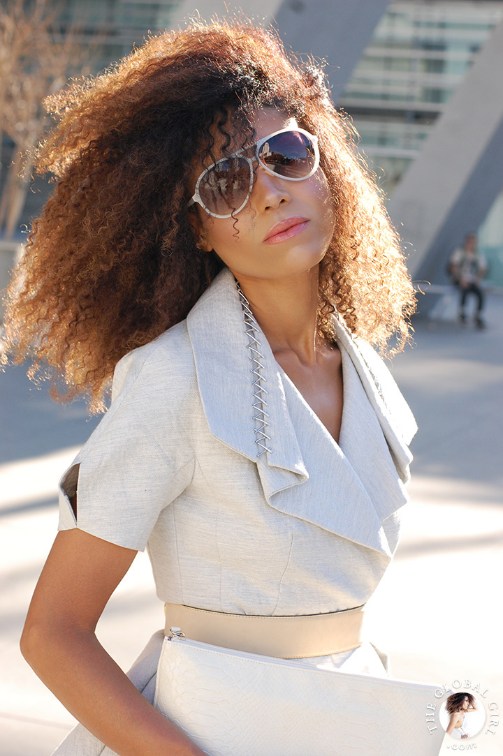 Ndoema rocks the chic women shorts suit look in a deconstructed jacket accessorized with aviator sunglasses.