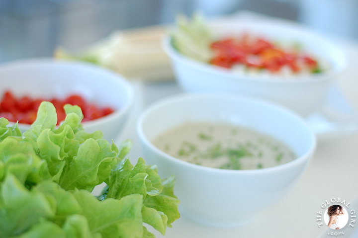 Crunchy corn salad with creamy dairy free dressing on a bed of curly leaf lettuce. Totally raw, vegan, gluten free and oil free.