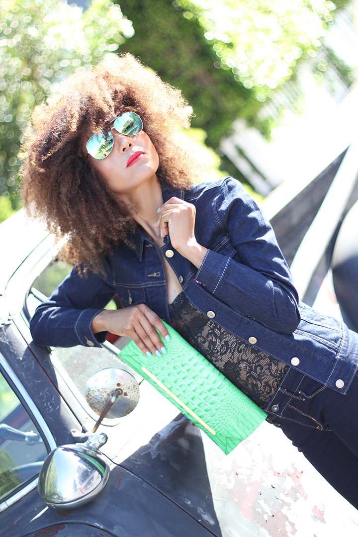 Live in Levi's: Ndoema rocks the denim on denim look in mid rise skinny jeans with a matching classic Levi's trucker jacket.