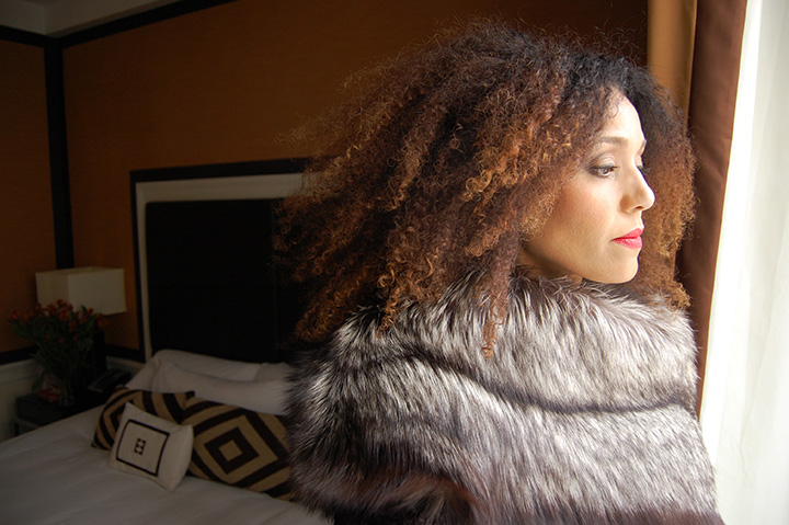 The Global Girl Daily Style: Ndoema photographed in a fur trimmed coat by Mimi Plange at the Empire Hotel during New York Fashion Week Fall 2014.