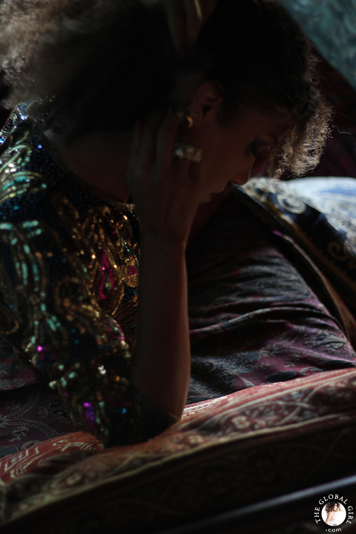 The Global Girl Fashion Editorials: Ndoema lounges Moroccan style in an opulent day bed in this photo shoot lensed by Phillip James. She sports a bohemian chic look complete with silk palazzo pants styled with a vintage sequined paisley blouse and Miu Miu jeweled sandals.