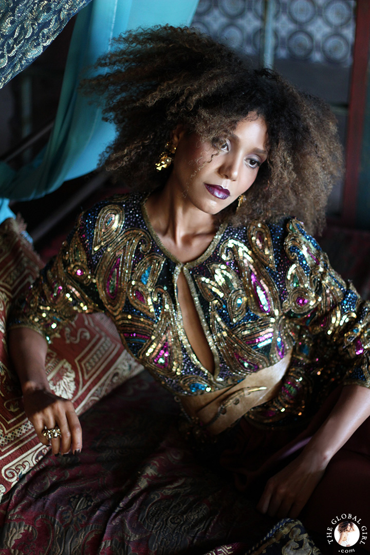 The Global Girl Fashion Editorials: Ndoema lounges Moroccan style in an opulent day bed in this photo shoot lensed by Phillip James. She sports a bohemian chic look complete with vintage sequined paisley blouse and gold jewelry.