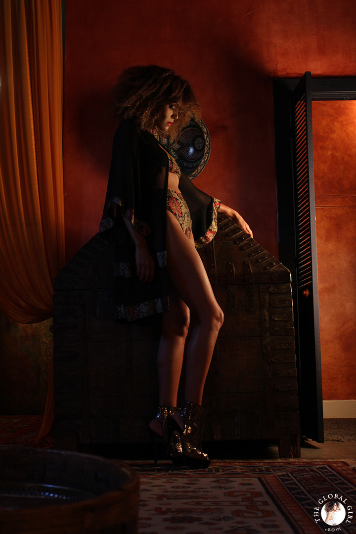 A Night in Casablanca: In this Moroccan themed fashion editorial, Ndoema sports a silk kaftan with high waist briefs and matching bustier bra accessorized with gold sequin open toe boots.