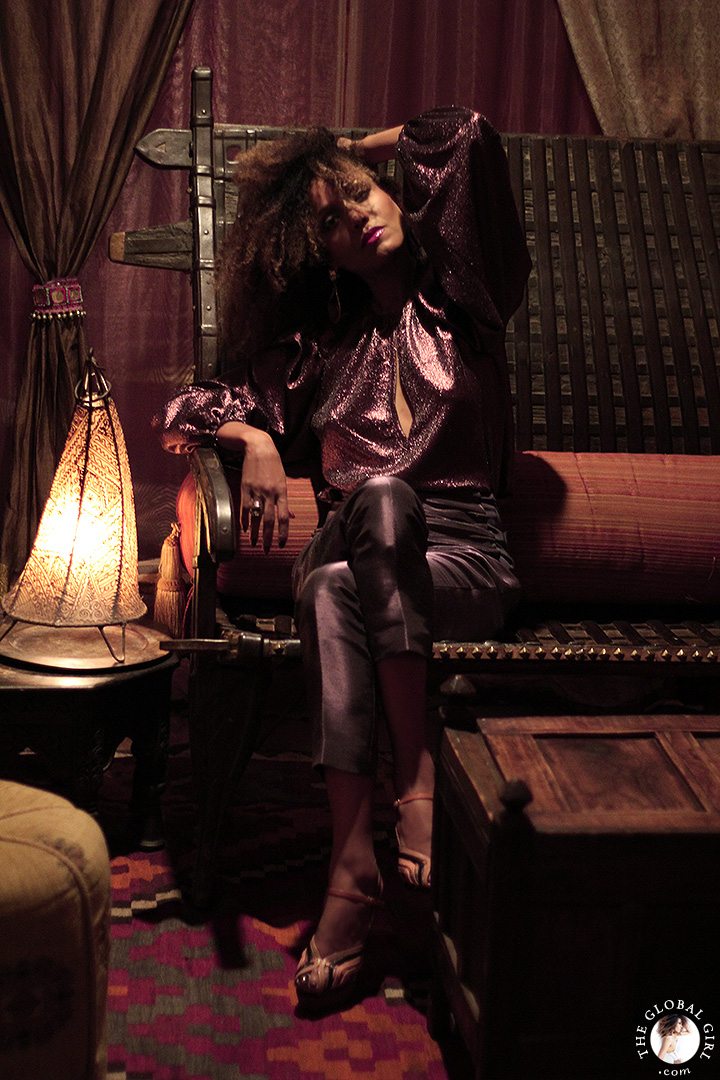 Ndoema glimmers in a head-to-toe purple look in this Moroccan inspired fashion editorial lensed by Phillip James.