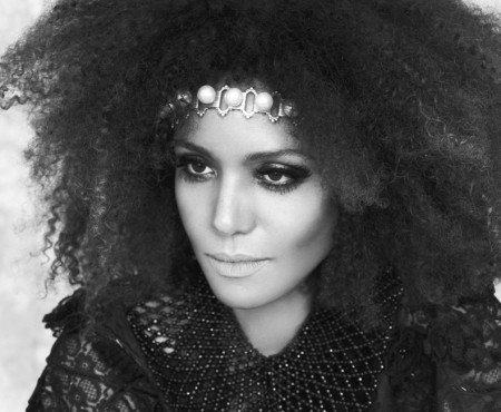 Ndoema rocks a seventies inspired look with her trademark big natural hair.