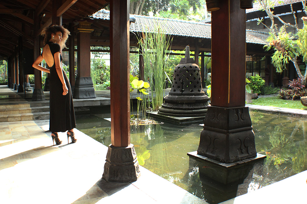 The Global Girl Travels: Ndoema at Hyatt Regency Yogyakarta in Indonesia. A green oasis in the island of Java. Black backless maxi dress by Tadashi Shoji.