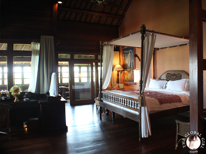 The Global Girl Travels: Magical Bali Getaway - The rich all-wood Rejang suite boasts a stunning hand-carved four-poster bed and assorted furniture hand-crafted by local Balinese artisans.