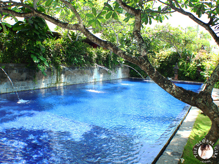 The Global Girl Travels: Magical Bali Getaway - Beautiful fountain pool inspired by the holy springs at Bali's Tirta Empul Temple.