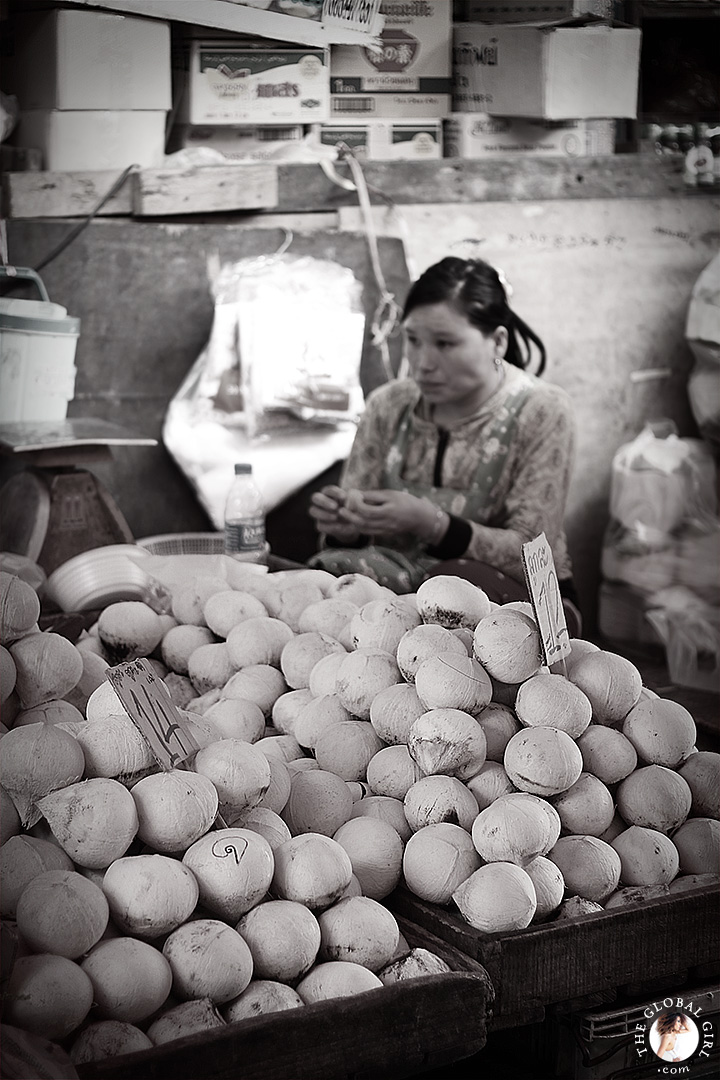 The Global Girl Travels: Coconut merchant at Khlong Toey market in Bangkok, Thailand.