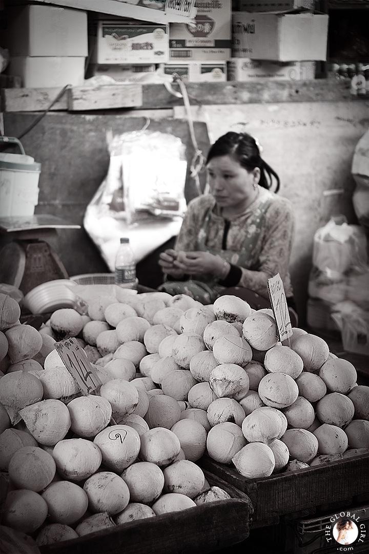 The Global Girl Travels: Coconut merchant at Khlong Toey market in Bangkok, Thailand.
