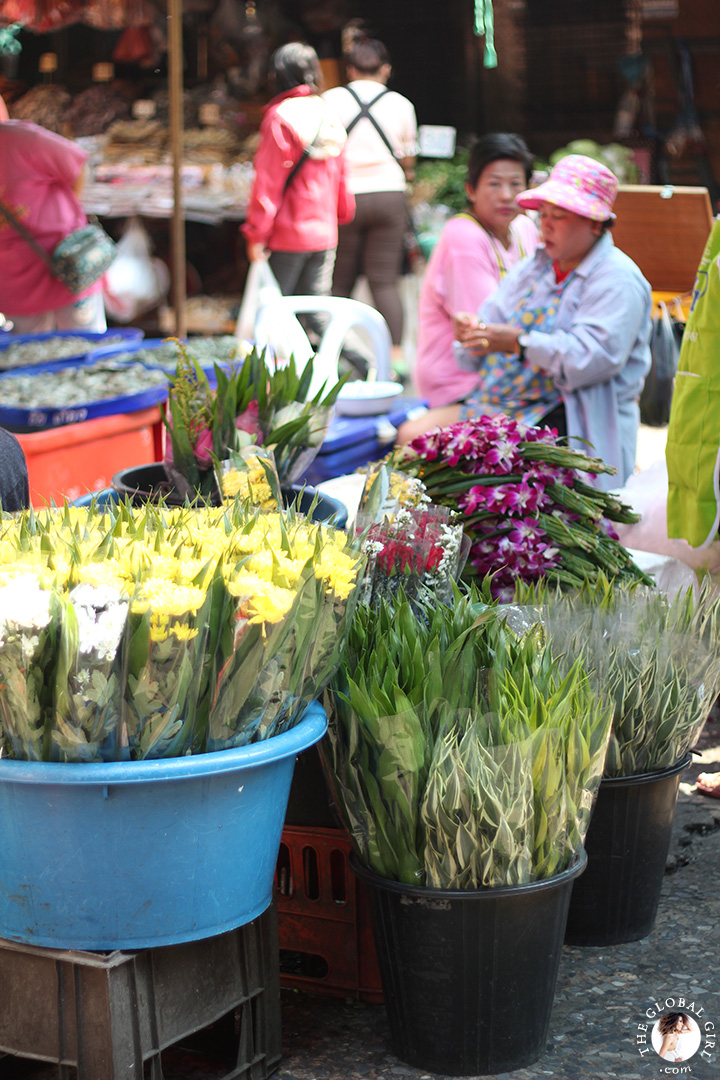 The Global Girl Travels: Flower stand at Khlong Toey market in Bangkok, Thailand.