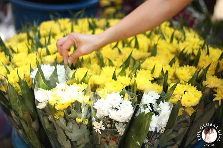 The Global Girl Travels: Colorful flowers at Khlong Toey market in Bangkok, Thailand.