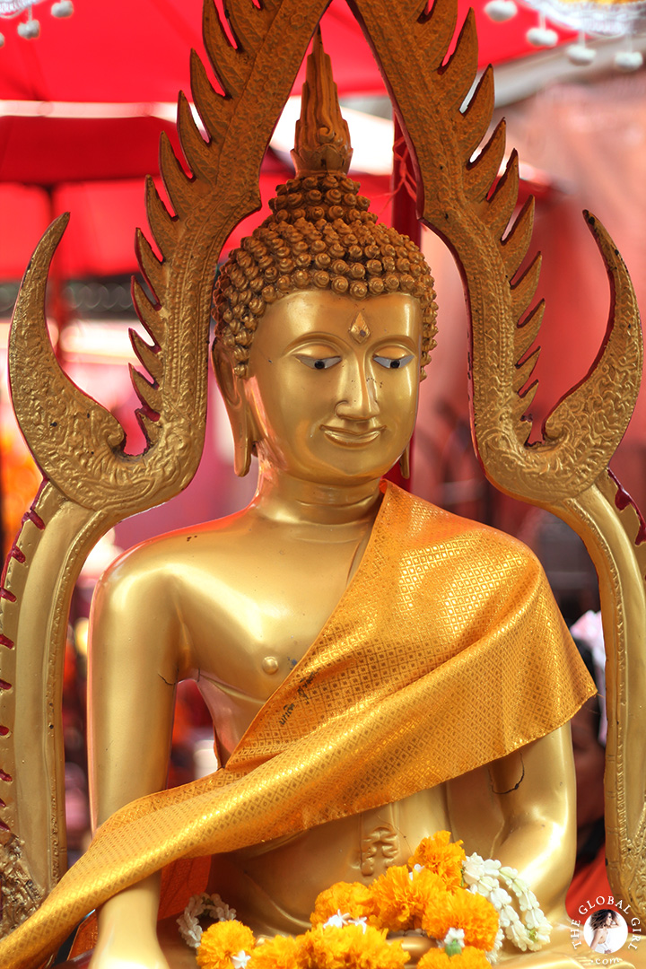 The Global Girl Travels: Beautiful gold buddha at Khlong Toey market in Bangkok, Thailand.