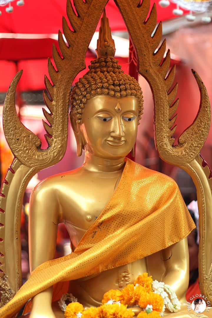 The Global Girl Travels: Beautiful gold buddha at Khlong Toey market in Bangkok, Thailand.