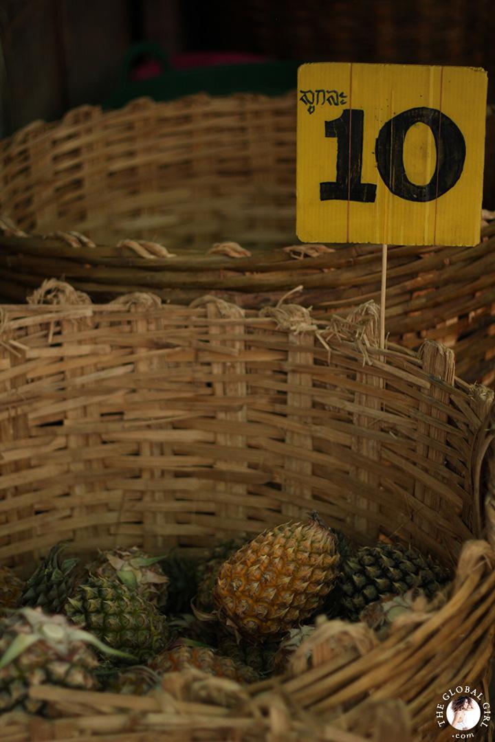 The Global Girl Travels: Fresh pineapple at Khlong Toey market in Bangkok, Thailand.