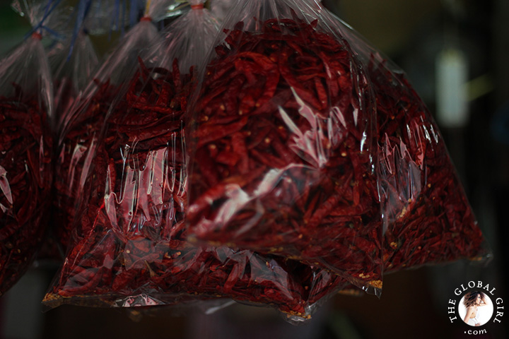 The Global Girl Travels: Red dragon peppers at Khlong Toey market in Bangkok, Thailand.