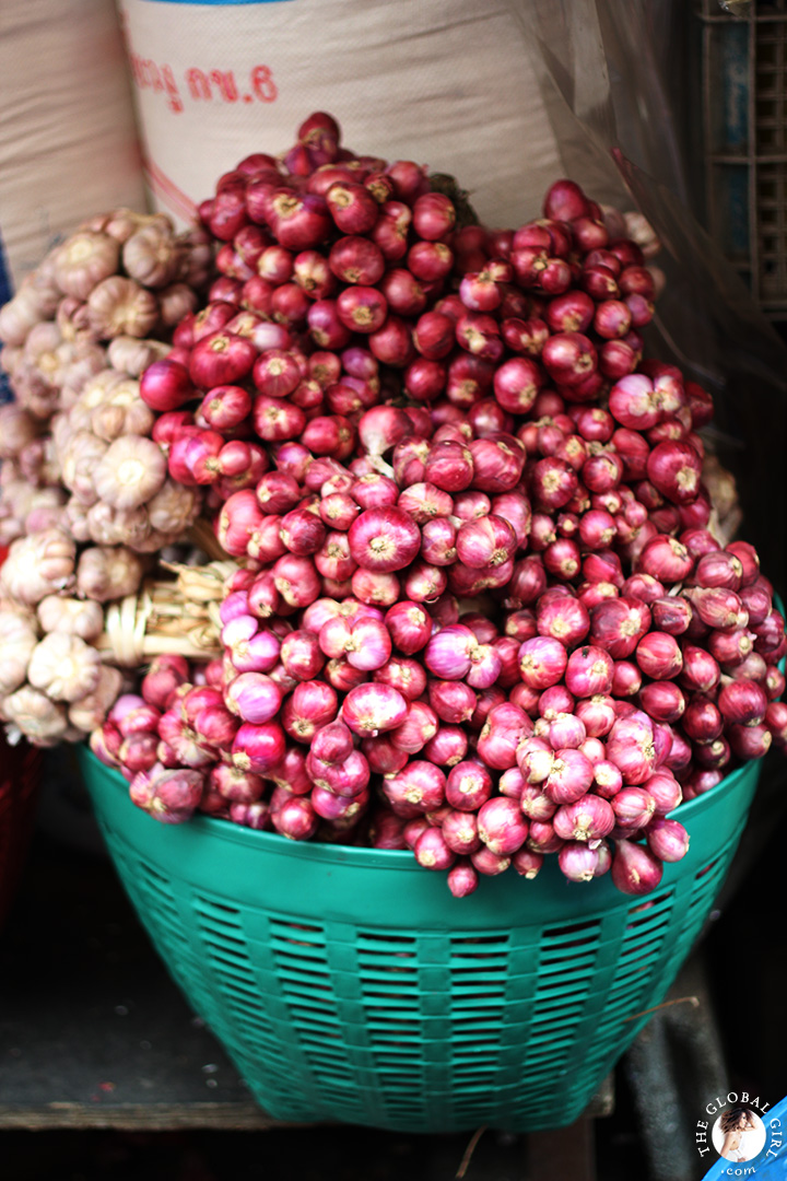 The Global Girl Travels: Shallots at Khlong Toey market in Bangkok, Thailand.