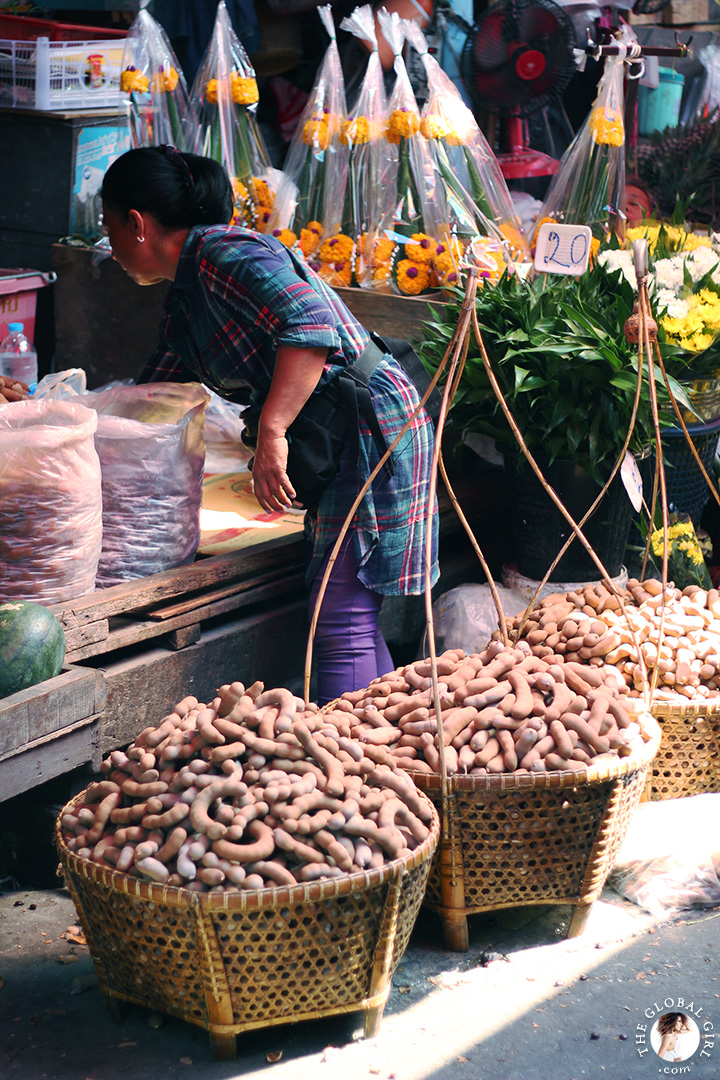 The Global Girl Travels: Shopping for fresh produce at Khlong Toey market in Bangkok, Thailand. Tamarind is a staple of Thai cuisine but this sweet and tangy tropical fruit is also packed with collagen-boosting Vitamin C.
